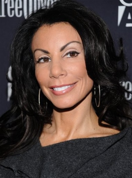 danielle staub sex tape Romantic porn picture of a woman covered in sand and having sex on a beach.